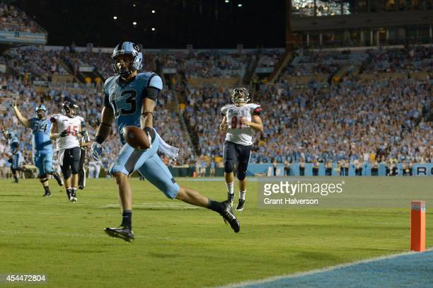 Mack Hollins of the North Carolina Tar Heels scores a touchdown during the third quarter against the Liberty Flames at Kenan Stadium on August 30...