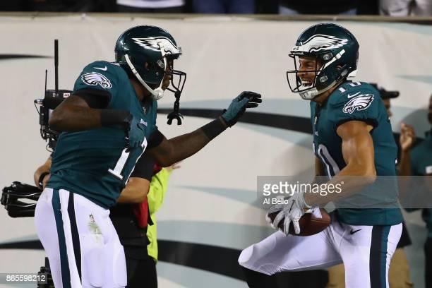 Mack Hollins of the Philadelphia Eagles celebrates his 64yard touchdown with teammate Alshon Jeffery against the Washington Redskins during the...