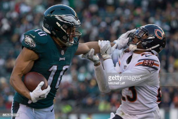Mack Hollins of the Philadelphia Eagles stiff arms Kyle Fuller of the Chicago Bears at Lincoln Financial Field on November 26 2017 in Philadelphia...