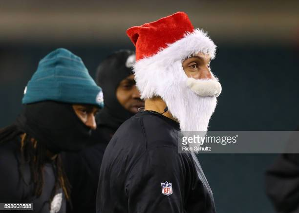 Mack Hollins of the Philadelphia Eagles wears a Santa hat and beard as he warms up prior to a game against the Oakland Raiders at Lincoln Financial...