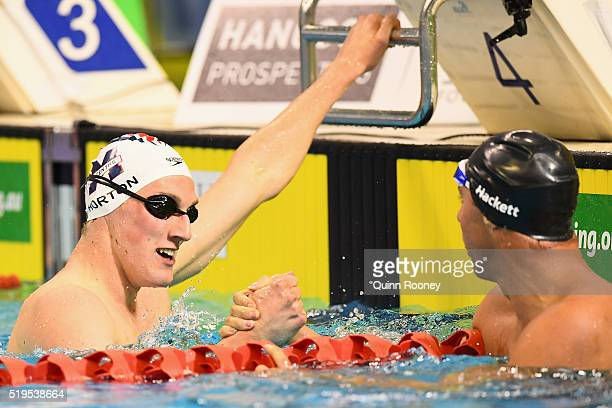 Mack Horton and Grant Hackett of Australia shake hands after competing in the Men's 400 Freestyle during day one of the 2016 Hancock Prospecting...