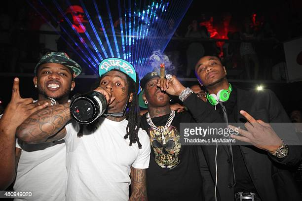 Mack Maine Lil Wayne Birdman and DJ Efeezy ring in the New Year on December 31 2014 in Miami Florida