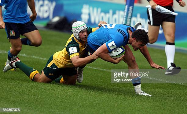 Mack Mason of Australia tackles Marco Zanon of Italy during the World Rugby U20 Championship match between Australia and Italy at AJ Bell Stadium on...