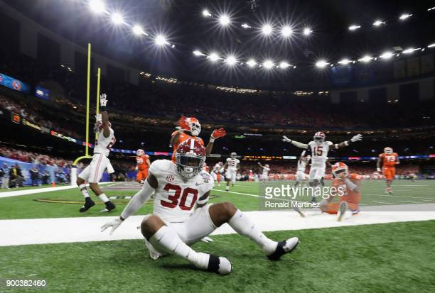Mack Wilson of the Alabama Crimson Tide scores a touchdown on an interception in the second half of the AllState Sugar Bowl against the Clemson...
