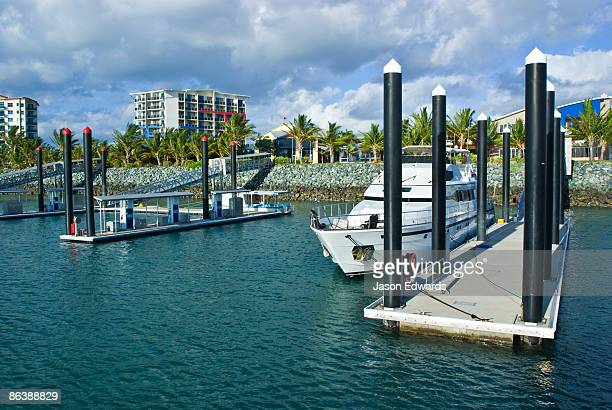 A modern marina and boat refueling station in tropical Queensland.