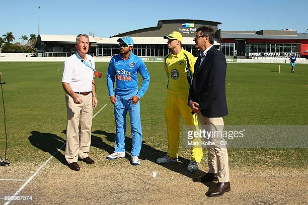 Mackay mayor Greg Williamson tosses the coin with India A captain Manish Pandey Australia A captain Peter Handscomb and match referee Steve Benaud...