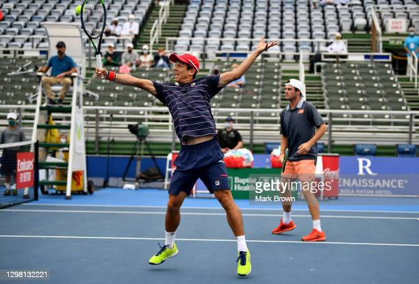 Mackenize McDonald returns the shot against Ariel Behar of Uruguay and Gonzalo Escobar of Ecuador while playing with Tommy Paul during the Doubles...