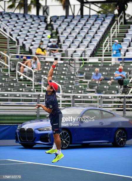 Mackenize McDonald serves to Ariel Behar of Uruguay and Gonzalo Escobar of Ecuador while playing with Tommy Paul during the Doubles Semifinals of the...