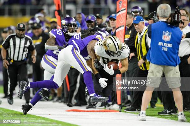 Mackensie Alexander and Anthony Harris of the Minnesota Vikings push Willie Snead of the New Orleans Saints out of bounds during the second half of...