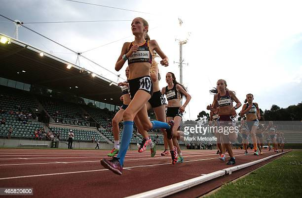 Mackenze Ormiston of Queensland leads the field in the Under 15 Womens 3000m event during the Australian Junior Athletics Championships at Sydney...