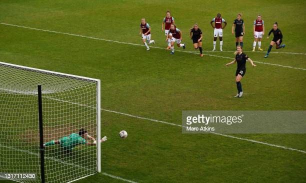 Mackenzie Arnold of West Ham United saves a penalty from Sam Mewis of Manchester City during the Barclays FA Women's Super League match between West...