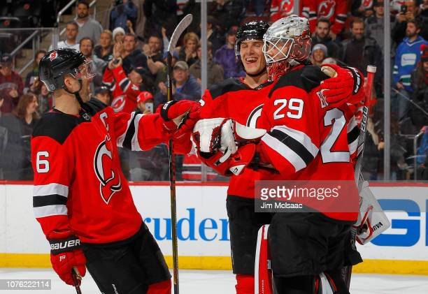 Mackenzie Blackwood of the New Jersey Devils celebrates his shut out victory against the Vancouver Canucks with teammates Andy Greene and Steven...