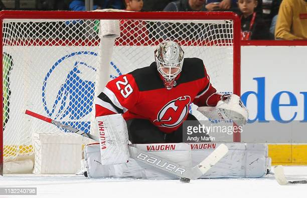 Mackenzie Blackwood of the New Jersey Devils defends the net against the Arizona Coyotes during the game at Prudential Center on March 23 2019 in...
