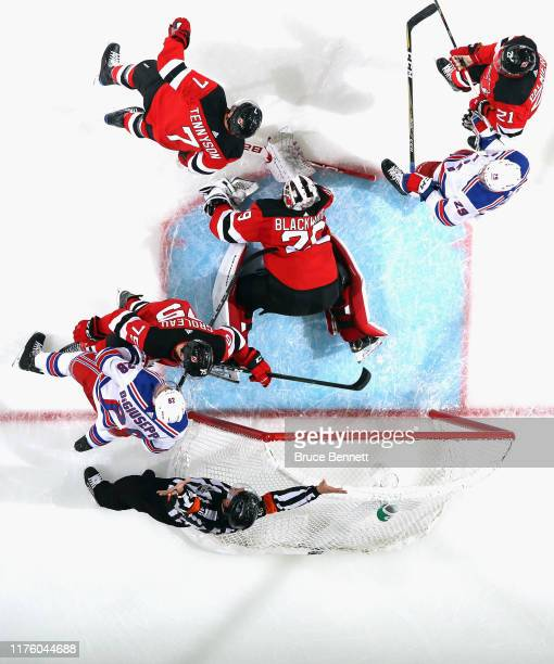 Mackenzie Blackwood of the New Jersey Devils defends the net against the New York Rangers at the Prudential Center on September 20 2019 in Newark New...