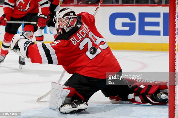 Mackenzie Blackwood of the New Jersey Devils is unable to stop a shot from JeanGabriel Pageau of the Ottawa Senators in the third period at...