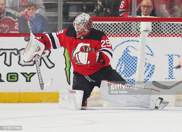 Mackenzie Blackwood of the New Jersey Devils makes a blocker save against the Vancouver Canucks during the game at Prudential Center on December 31...