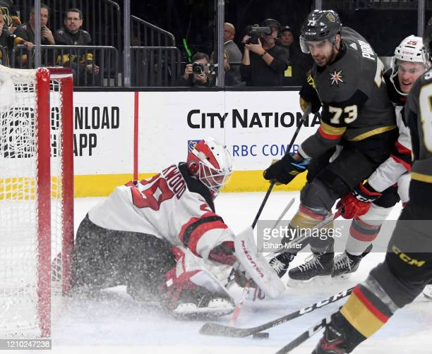 Mackenzie Blackwood of the New Jersey Devils makes a save against Brandon Pirri of the Vegas Golden Knights in the second period of their game at...