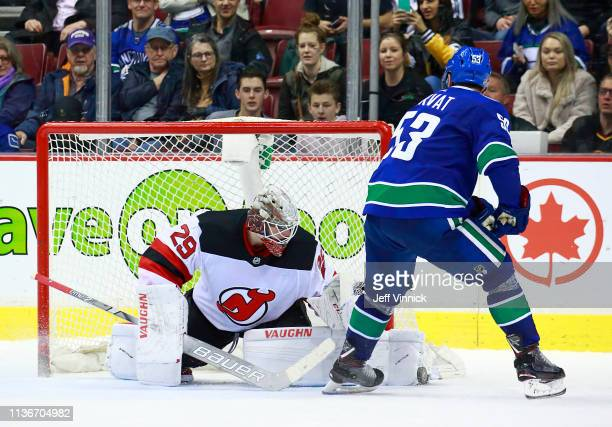 Mackenzie Blackwood of the New Jersey Devils makes a save on Bo Horvat of the Vancouver Canucks in the shootout during their NHL game at Rogers Arena...