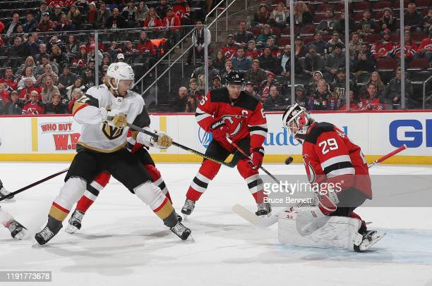 Mackenzie Blackwood of the New Jersey Devils makes the first period save on William Karlsson of the Vegas Golden Knights at the Prudential Center on...