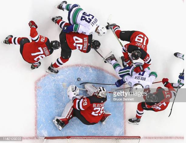 Mackenzie Blackwood of the New Jersey Devils makes the second period save against the Vancouver Canucks en route to a 10 shutout at the Prudential...