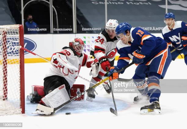 Mackenzie Blackwood of the New Jersey Devils makes the second period save on Mathew Barzal of the New York Islanders at the Nassau Coliseum on March...