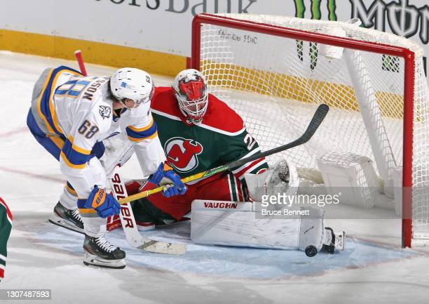 Mackenzie Blackwood of the New Jersey Devils makes the third period save n Victor Olofsson of the Buffalo Sabres at the Prudential Center on March...