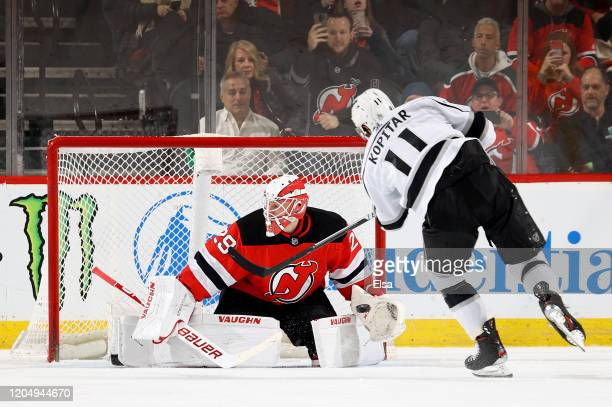Mackenzie Blackwood of the New Jersey Devils stops a penalty shot by Anze Kopitar of the Los Angeles Kings in the second period at Prudential Center...