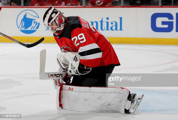 Mackenzie Blackwood of the New Jersey Devils stops a shot in the first period against the Pittsburgh Penguins at Prudential Center on November 15...