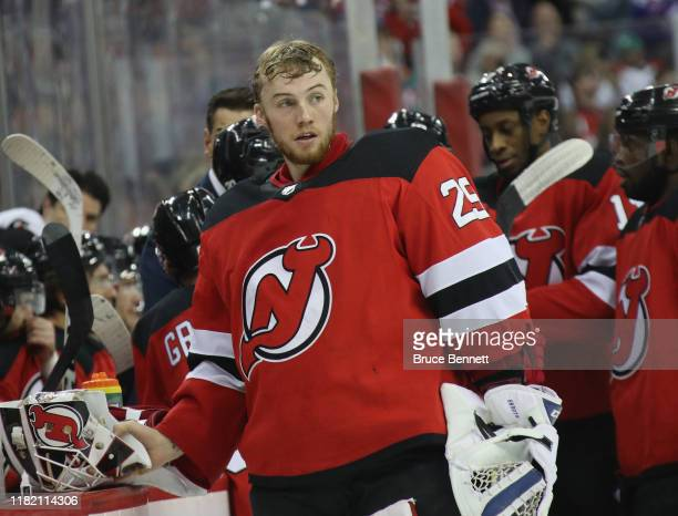 Mackenzie Blackwood of the New Jersey Devils takes a break during the third period of his 10 shutout against the Vancouver Canucks at the Prudential...