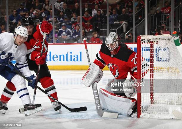 Mackenzie Blackwood of the New Jersey Devils tends net in his first NHL game against the Toronto Maple Leafs at the Prudential Center on December 18...