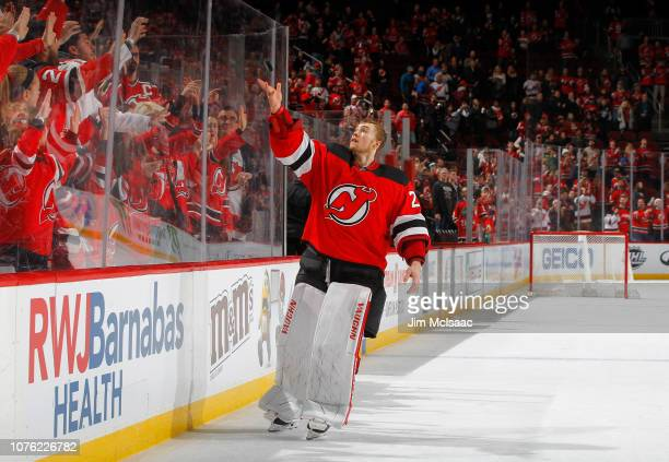 Mackenzie Blackwood of the New Jersey Devils throws a puck to the fans after being named the star of a game against the Vancouver Canucks at...
