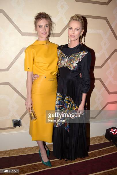 Mackenzie Davis and Charlize Theron attend the premiere of Focus Features' 'Tully' at Regal LA Live Stadium 14 on April 18 2018 in Los Angeles...