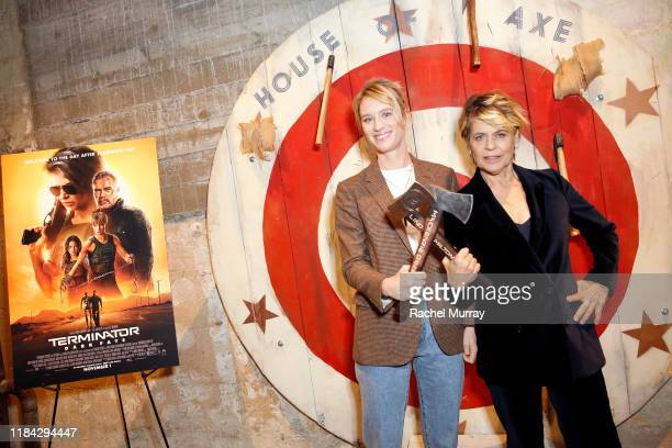 Mackenzie Davis and Linda Hamilton attend an axe throwing event prior to the Terminator Dark Fate Screening at the ArcLight Hollywood on October 29...