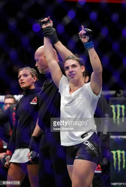 Mackenzie Dern celebrates her split decision victory over Ashley Yoder following their women's strawweight bout during UFC 222 at TMobile Arena on...
