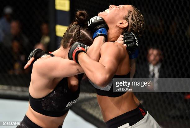 Mackenzie Dern clinches with Ashley Yoder in their women's strawweight bout during the UFC 222 event inside TMobile Arena on March 3 2018 in Las...