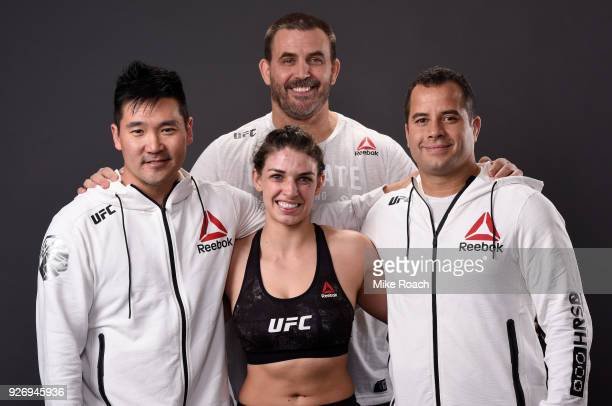 Mackenzie Dern poses for a portrait backstage with her team after her victory over Ashley Yoder during the UFC 222 event inside TMobile Arena on...
