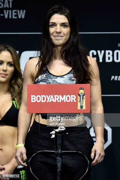 Mackenzie Dern poses on the scale during a UFC 222 weighin on March 2 2018 in Las Vegas Nevada