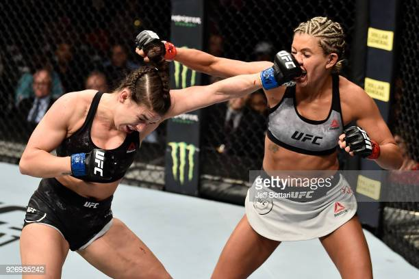 Mackenzie Dern punches Ashley Yoder in their women's strawweight bout during the UFC 222 event inside TMobile Arena on March 3 2018 in Las Vegas...