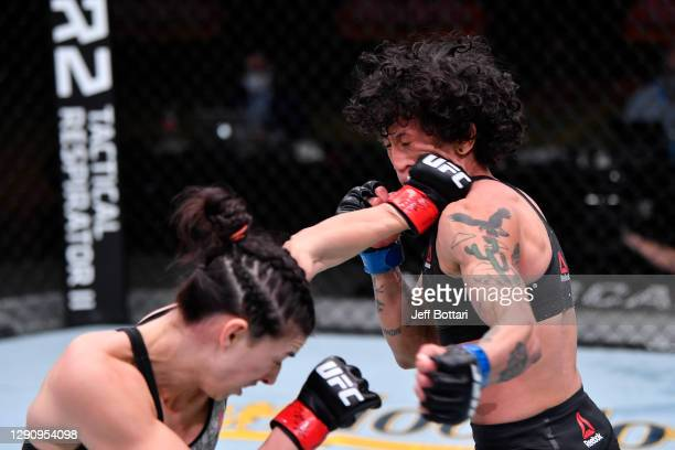 Mackenzie Dern punches Virna Jandiroba of Brazil in their women's strawweight bout during the UFC 256 event at UFC APEX on December 12, 2020 in Las...