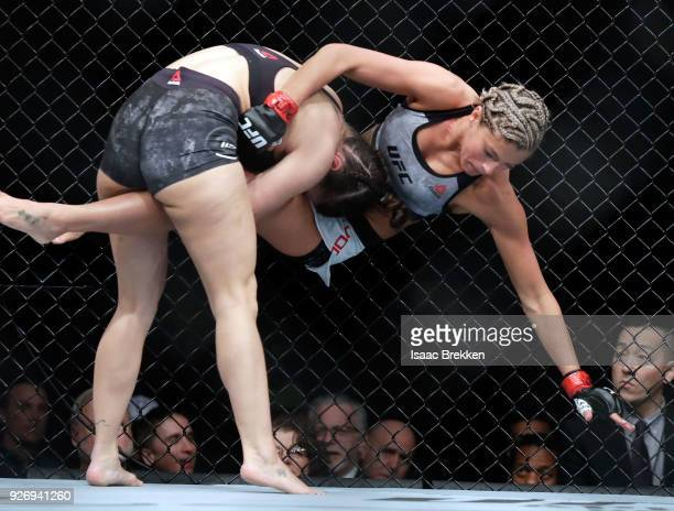 Mackenzie Dern takes down Ashley Yoder during their women's strawweight bout during UFC 222 at TMobile Arena on March 3 2018 in Las Vegas Nevada Dern...