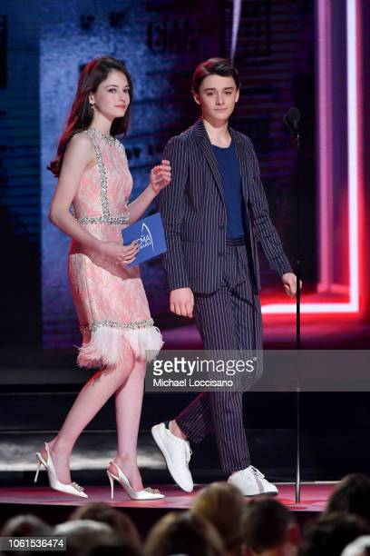 Mackenzie Foy and Noah Schnapp speak onstage during the 52nd annual CMA Awards at the Bridgestone Arena on November 14 2018 in Nashville Tennessee