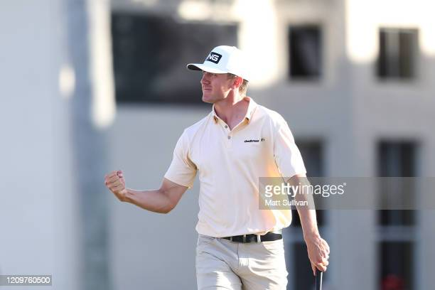 MacKenzie Hughes of Canada celebrates after making a birdie putt on the 17th hole during the final round of the Honda Classic at PGA National Resort...