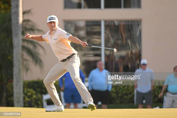 Mackenzie Hughes of Canada fist pumps while making a putt on the 17th green during the final round of The Honda Classic at PGA National Champion...