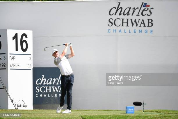 Mackenzie Hughes of Canada hits a shot on the sixteenth tee during the final round of the Charles Schwab Challenge at Colonial Country Club on May 26...