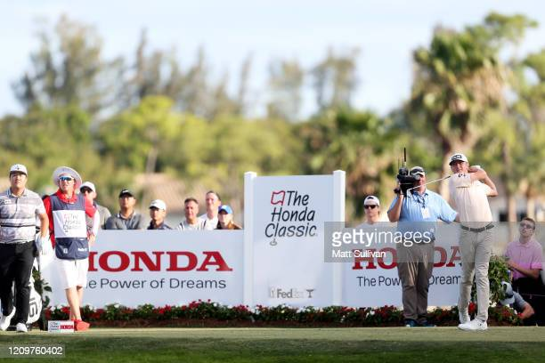 MacKenzie Hughes of Canada hits his tee shot on the 16th hole during the Honda Classic at PGA National Resort and Spa Champion course on March 01...
