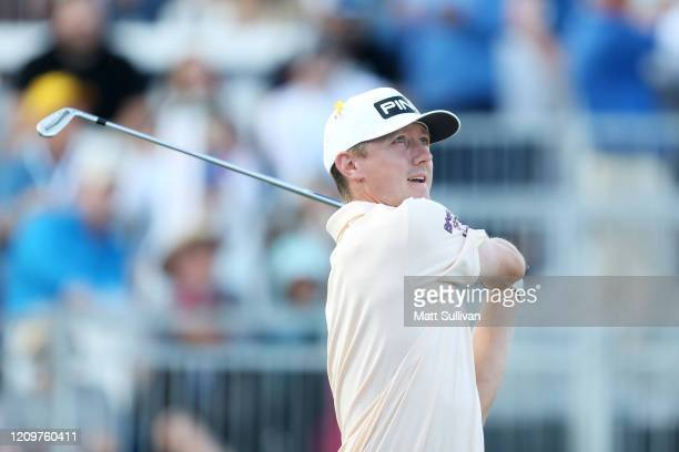 MacKenzie Hughes of Canada hits his tee shot on the 17th hole during the Honda Classic at PGA National Resort and Spa Champion course on March 01...