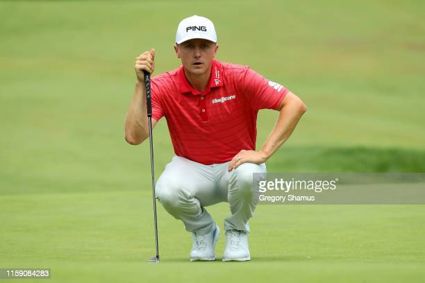 Mackenzie Hughes of Canada lines up a putt on the eighth green during round three of the Rocket Mortgage Classic at the Detroit Country Club on June...