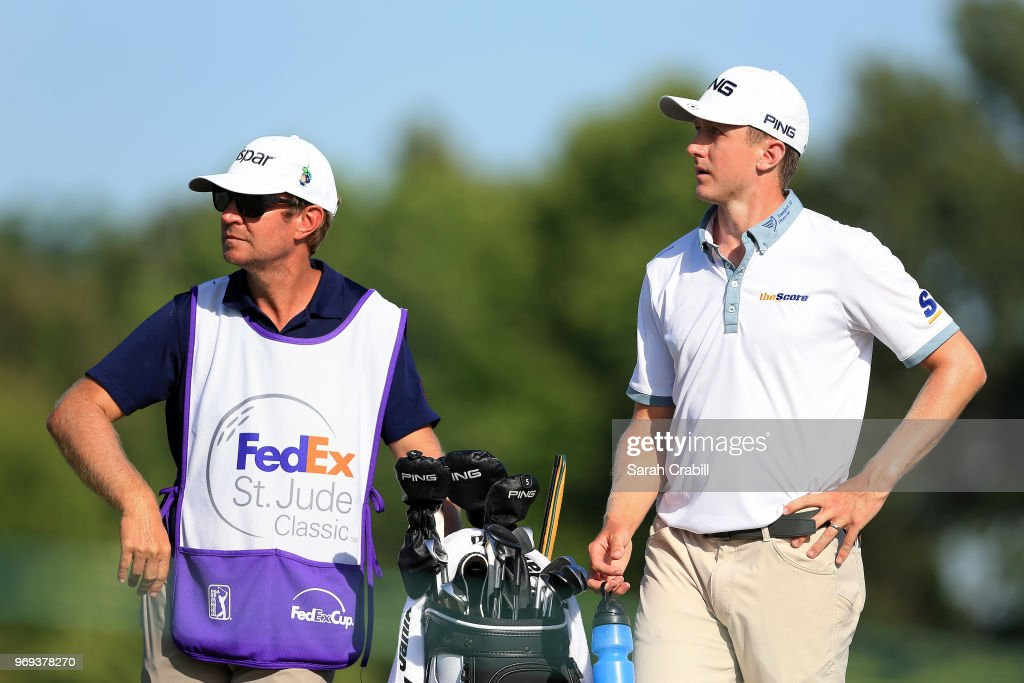 Mackenzie Hughes of Canada looks on with his caddie from the ninth tee during the first round of the FedEx St. Jude Classic at TPC Southwind on June 7, 2018 in Memphis, Tennessee.
