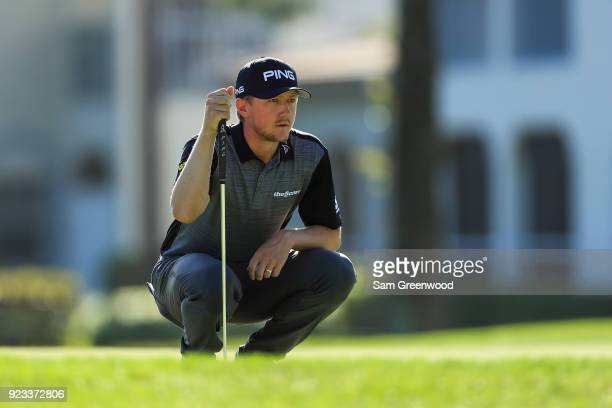 Mackenzie Hughes of Canada looks over a putt on the seventh hole during the second round of the Honda Classic at PGA National Resort and Spa on...