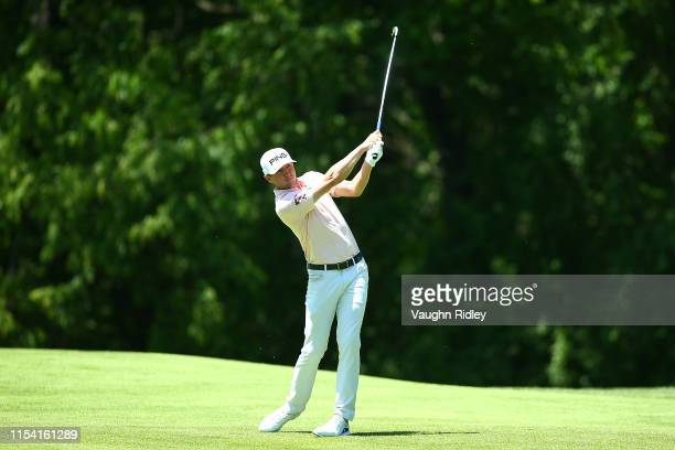 Mackenzie Hughes of Canada plays a shot on the fourth hole during the first round of the RBC Canadian Open at Hamilton Golf and Country Club on June...